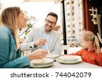 young parents dining in a... | Shutterstock . vector #744042079