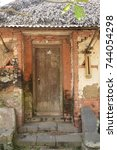 Small photo of Old wooden door of an house inside Tenganan Aga aboriginal village in Bali, Indonesia