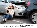 injured girl after car accident ... | Shutterstock . vector #744057826
