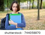 Small photo of Sad flunk out student face expression portrait on autumnal background