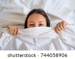 funny woman hiding her face... | Shutterstock . vector #744058906