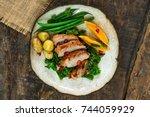 roast duck fillets with orange... | Shutterstock . vector #744059929