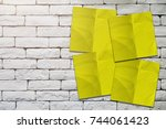 yellow paper notepad stick on... | Shutterstock . vector #744061423
