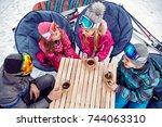 smiling family enjoying on hot... | Shutterstock . vector #744063310