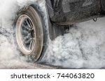 drag racing car burns rubber... | Shutterstock . vector #744063820