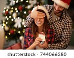 christmas couple with present | Shutterstock . vector #744066280