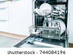 open dishwasher with clean... | Shutterstock . vector #744084196