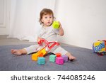 little happy girl playing with... | Shutterstock . vector #744085246