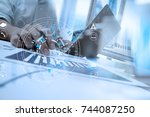 businessman hand working with... | Shutterstock . vector #744087250