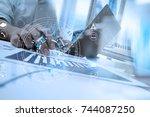 businessman hand working with... | Shutterstock . vector #744087250