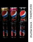 London, 24th October 2017:- Cans of Pepsi Max solated on a black background - stock photo
