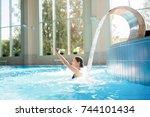 young happy woman enjoying warm ... | Shutterstock . vector #744101434