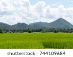 green field with mountain and... | Shutterstock . vector #744109684