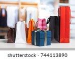 shopping bag on wooden table | Shutterstock . vector #744113890