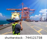 foreman at container terminal... | Shutterstock . vector #744121738