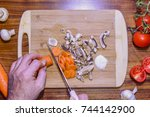 cutting mushroom and carrot on... | Shutterstock . vector #744142900