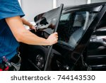 male specialist applying car... | Shutterstock . vector #744143530