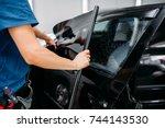 male specialist applying car...   Shutterstock . vector #744143530