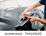 male specialist with scissors ... | Shutterstock . vector #744143620