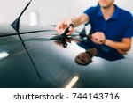 worker with scissors  car... | Shutterstock . vector #744143716