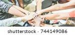 work team stacking hands... | Shutterstock . vector #744149086