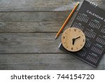 close up of clock  calendar and ... | Shutterstock . vector #744154720