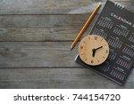 close up of clock  calendar and ... | Shutterstock . vector #744154720