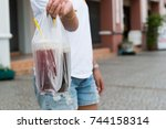 asian women hold plastic bag of ... | Shutterstock . vector #744158314