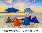 lounge chair in sunset in white ... | Shutterstock . vector #744158389