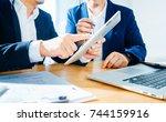 two businessman using digital... | Shutterstock . vector #744159916