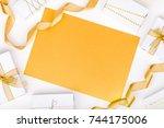 golden gift boxes on white... | Shutterstock . vector #744175006