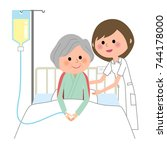 nurse hospitalized patient | Shutterstock .eps vector #744178000