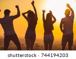 the four people dancing on the... | Shutterstock . vector #744194203
