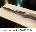 table setting with knife on... | Shutterstock . vector #744197164