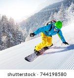 skier skiing downhill during... | Shutterstock . vector #744198580