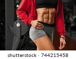 fitness sexy woman showing abs... | Shutterstock . vector #744215458