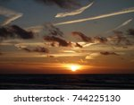 sunset at the north sea coast... | Shutterstock . vector #744225130