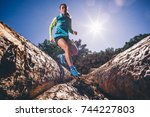 woman running on the mountain.... | Shutterstock . vector #744227803