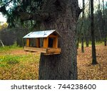 Stock photo bird feeder a bird house or bird box in summer with natural orange leaves on background wooden 744238600