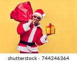 santa claus. young happy santa... | Shutterstock . vector #744246364