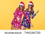 christmas new year. two young... | Shutterstock . vector #744246730