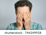middle aged man rubs tired eyes ... | Shutterstock . vector #744249928