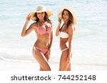 happy smiling female friends in ... | Shutterstock . vector #744252148