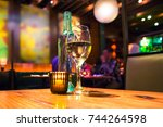 wine glass  bottle and candle...   Shutterstock . vector #744264598