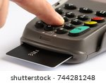 pos terminal with credit card.... | Shutterstock . vector #744281248