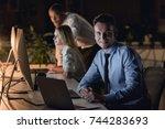 handsome businessman is looking ... | Shutterstock . vector #744283693