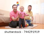 male gay couple with adopted... | Shutterstock . vector #744291919