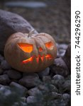 jack o lantern on the ground... | Shutterstock . vector #744296290
