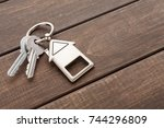 Two Steel Keys With House...