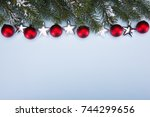 branches of christmas trees and ... | Shutterstock . vector #744299656